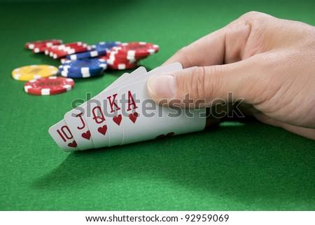 hand of royal flush - hearts - stock photo
