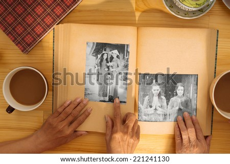 Hand of senior woman pointing at the girl on the black-and-white photo - stock photo