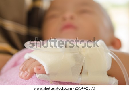 hand of sick asian Little boy  in mother holding  - stock photo