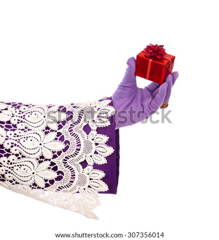 Hand of sinterklaas  with gift . typical Dutch character part of a traditional event celebrating the birthday of Sinterklaas (Santa Claus) in december. - stock photo