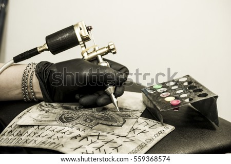 Tattoo machine ink sketches on tattoo stock photo for Tattoo artist education courses