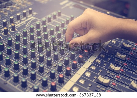 Hand of the audio musical mixer - stock photo