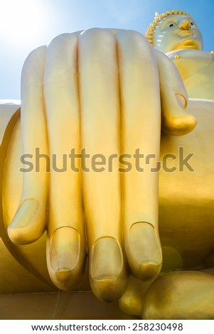 Hand of the Biggest Buddha in the world - Thailand  - stock photo