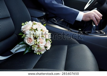 Hand of the driver of the car - stock photo
