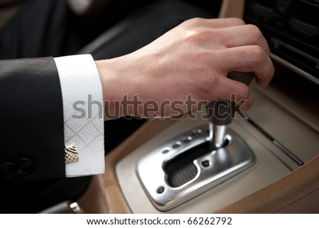 Hand of the driver of the car