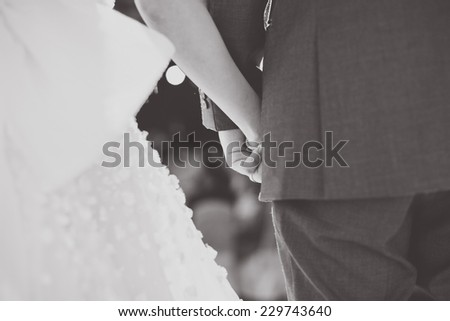 Hand of the groom and the bride. Monochrome image. vintage tone - stock photo