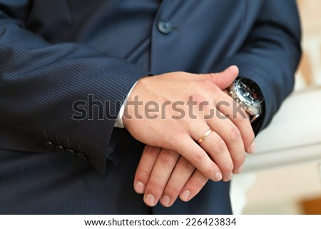 Hand of the groom  with wedding rings at a wedding party  - stock photo
