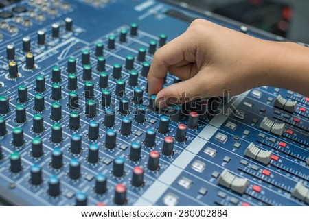 Hand of the mixer on soft focus and def of field effect - stock photo