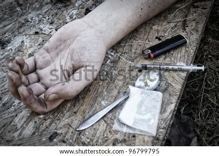 Hand of the narcotist - stock photo