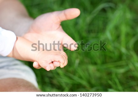Hand of the son in a hand of the father
