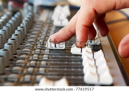 Hand of the sound producer - stock photo
