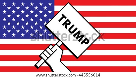 Hand of voter holding a sign saying Trump with the US flag in the background during the 2016 election. - stock photo