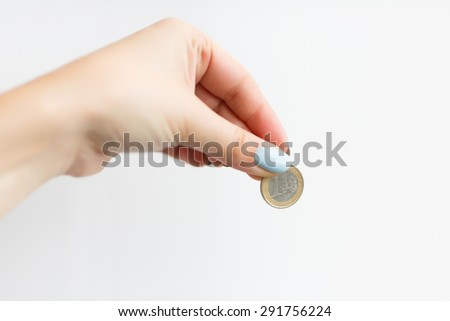 Hand of woman giving one euro on the white background