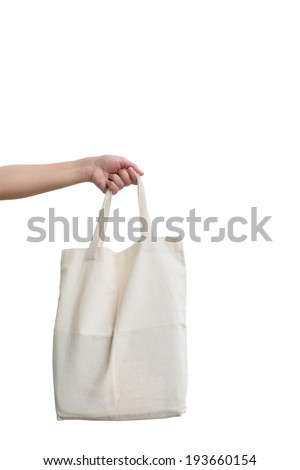 Hand of woman holding Fabric bag isolated on white background - stock photo