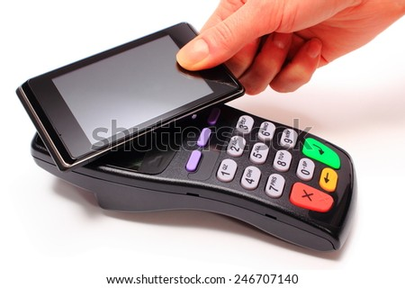 Hand of woman paying with NFC technology on mobile phone, credit card reader, payment terminal, finance concept - stock photo