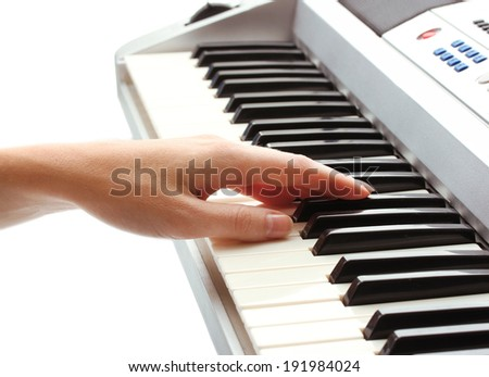 hand of woman playing synthesizer   - stock photo