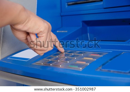 Hand of woman using a ATM.