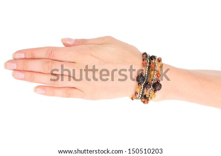 Hand of woman with colorful bracelets isolated on white background