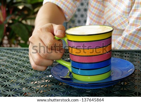 hand of young man drinking coffee - stock photo