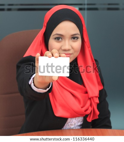 Hand of young muslim women holding white card - stock photo