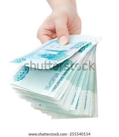 hand offer batch of many 1000 rouble bills (the 2nd biggest Russian bond) - stock photo