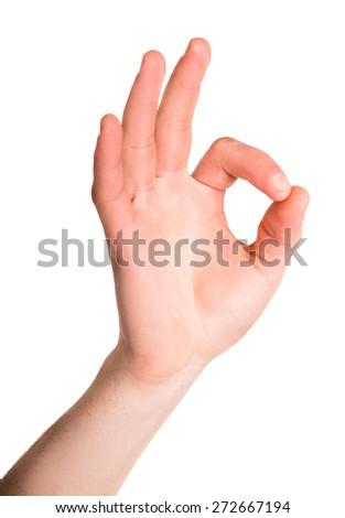 Hand OK sign isolated on white background. - stock photo