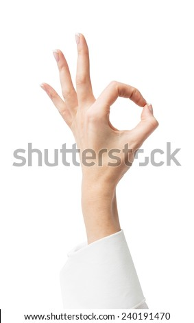 Hand OK sign on a white background - stock photo