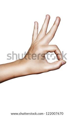 Hand OK sign on isolated background - stock photo