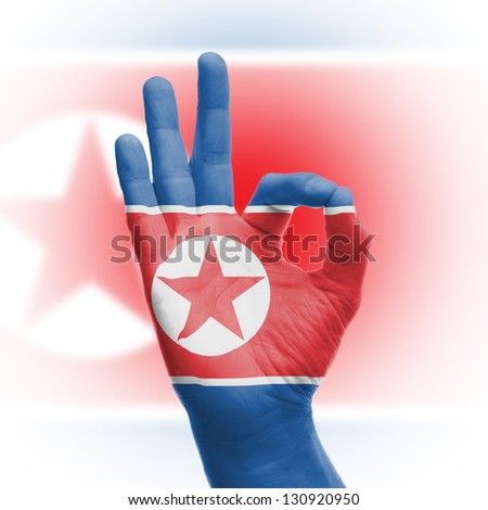 Hand OK sign, wrapped in the flag of North Korea