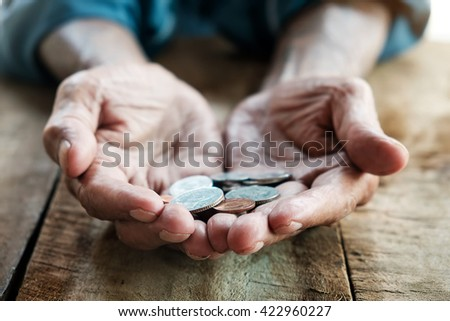 hand old man begging for money because of the hunger on the wood table