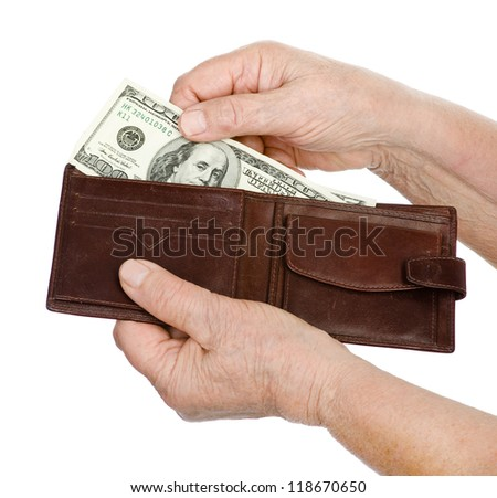 Hand old woman with dollar banknote. isolated on white background