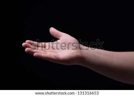 Hand on a black background