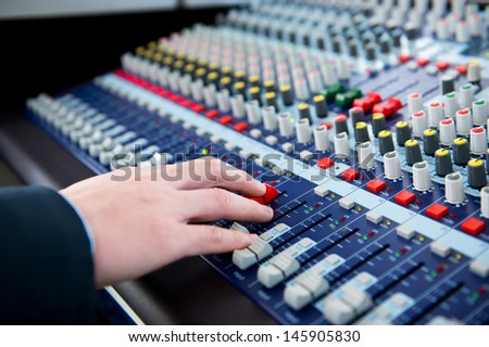 Hand on a sound mixer. - stock photo