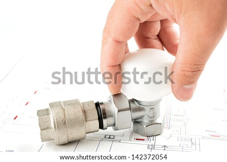 hand on a valve of heating system . - stock photo