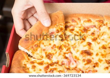 Hand on extra cheese pizza pan, stock photo - stock photo
