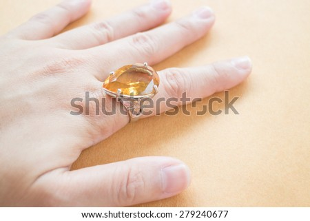 Hand on gem stone jewellery ring, stock photo