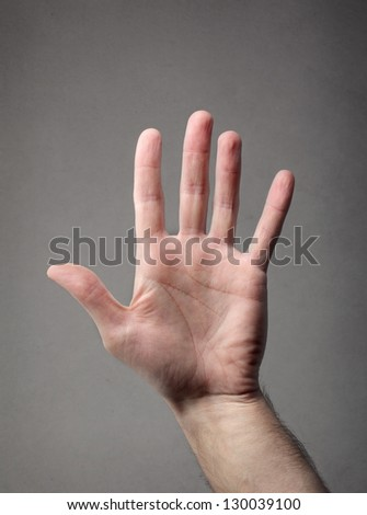 hand on gray background - stock photo