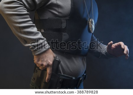 Hand on gun and on the move.  Undercover Law Enforcement Special Agent with weapon. - stock photo