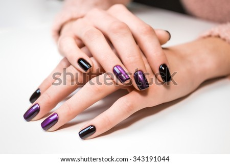 Hand on hand with nice manicure. Shellac complete Manicure process in salon nail salon. - stock photo