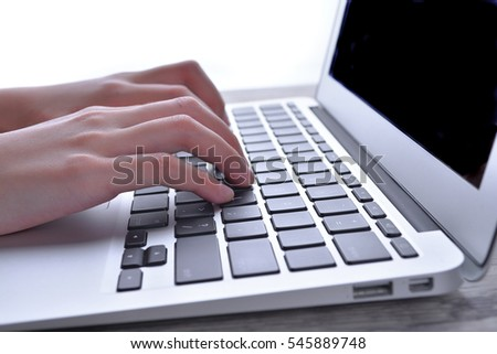 Hand on keyboard, information, connection, communication, and technology concept