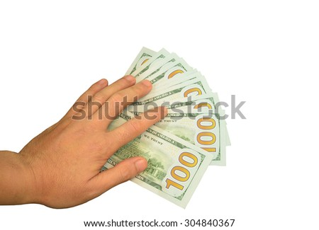 hand on many bundle of US 100 dollars bank notes isolated on white