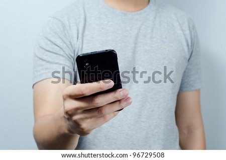 Hand on mobile phone - stock photo