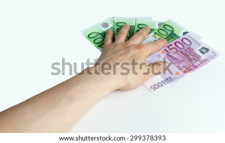 Hand on notes of euro