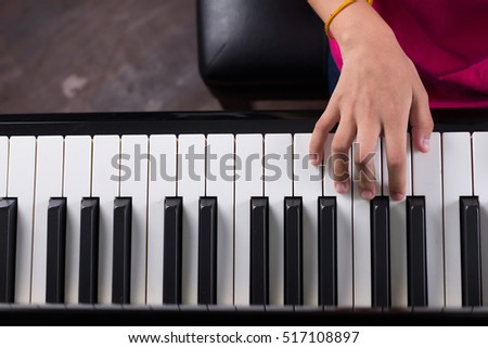 hand on piano/Playing piano /grand piano/music instrument