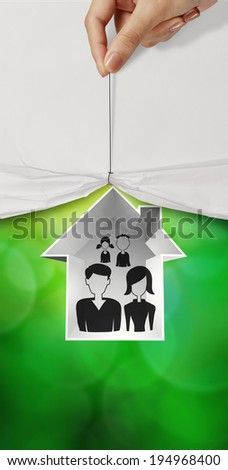 hand open crumpled paper to show hand draw family and house icon on green nature background as insurance concept  - stock photo