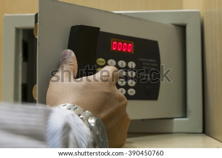 Hand open electronics safe - stock photo