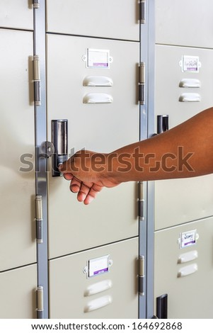 Hand open locker - stock photo