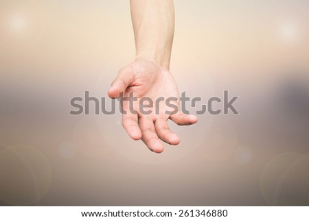 hand open palm gesture on blurred background with flare light. - stock photo