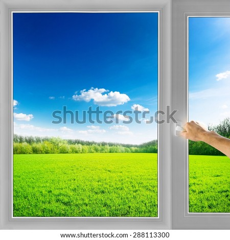 Hand open window field nature background - stock photo