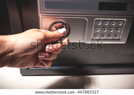 hand opened a safe, close up